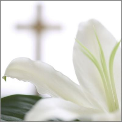 white-flower-cross-in-background